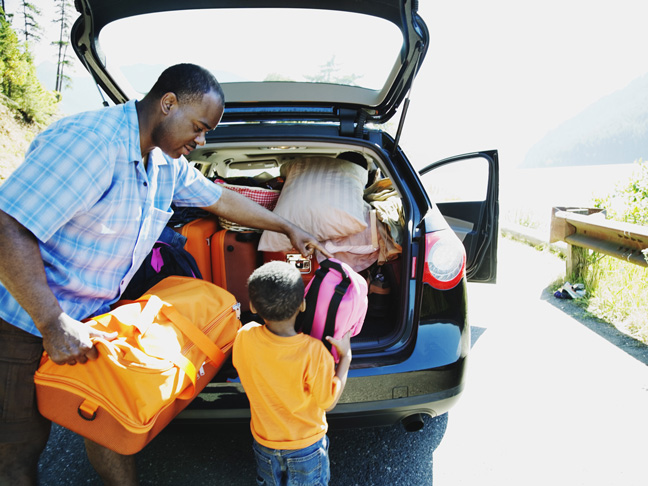 father-and-son-loading-trunk-car