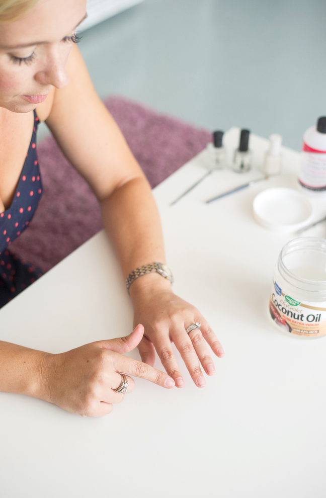 applying coconut oil to cuticles to soften