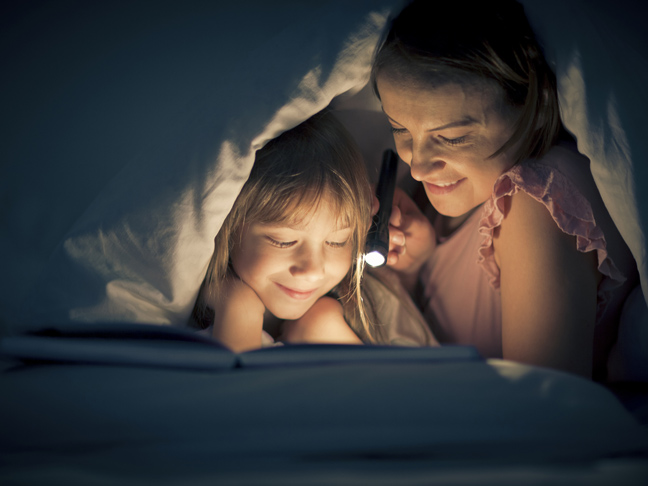 bedtime-reading-flashlight-mom-daughter