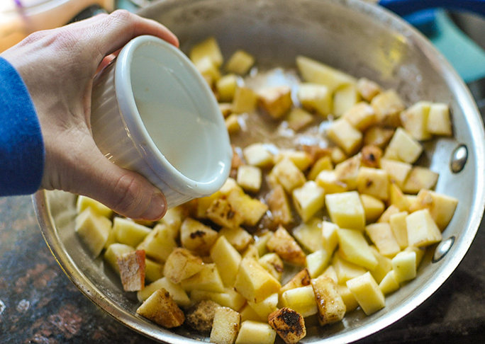 adding butter to the pie filling
