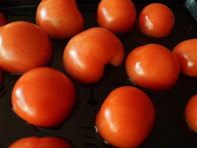 red-halved-tomatoes-stems-removed-baking-sheet-olive-oil