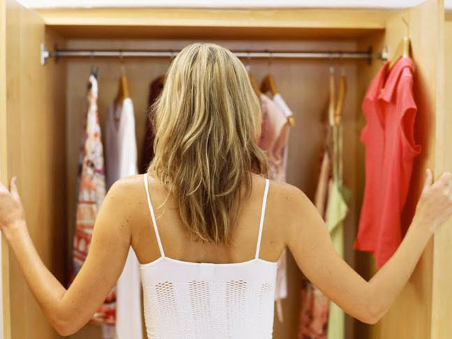 Woman cleaning out her closet