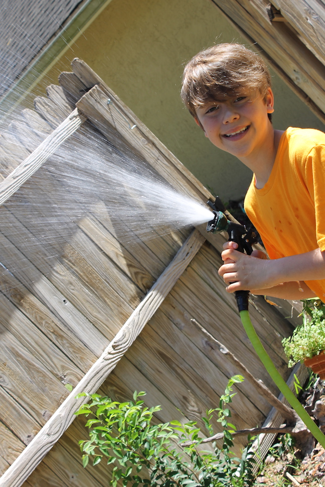 boy spraying a hose