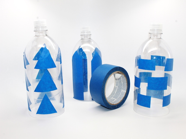 Step 2 - painter's tape on recycled water bottle