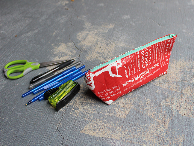 red zipper pouch pens stapler