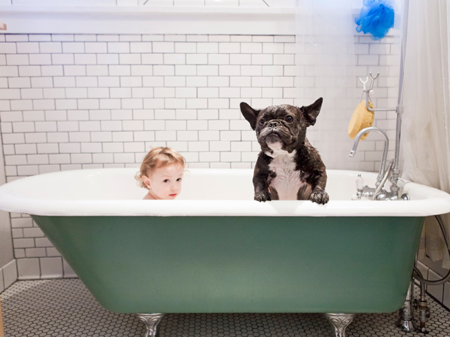 child-and-dog-in-tub