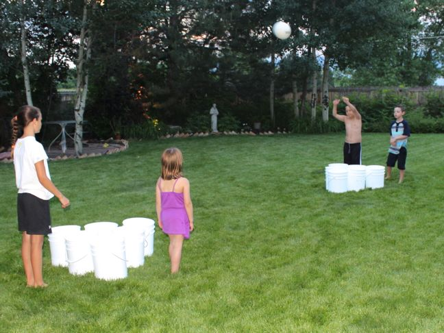 summer-backyard-games-boys-girls-bucket-ball-grass