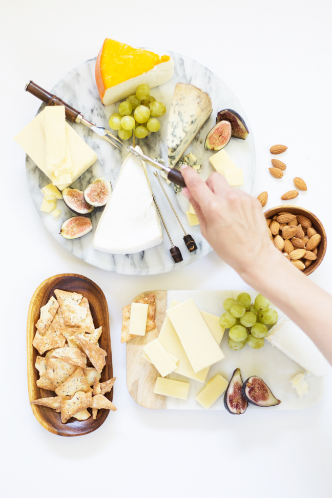 cheese-boards-hand-reaching