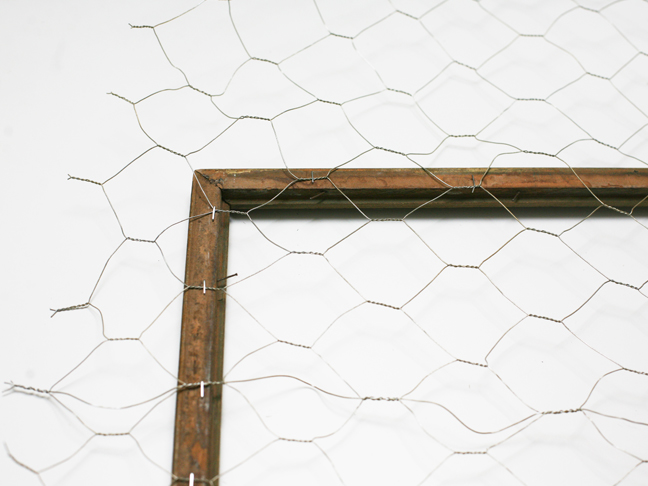 stapling chicken wire to the frame