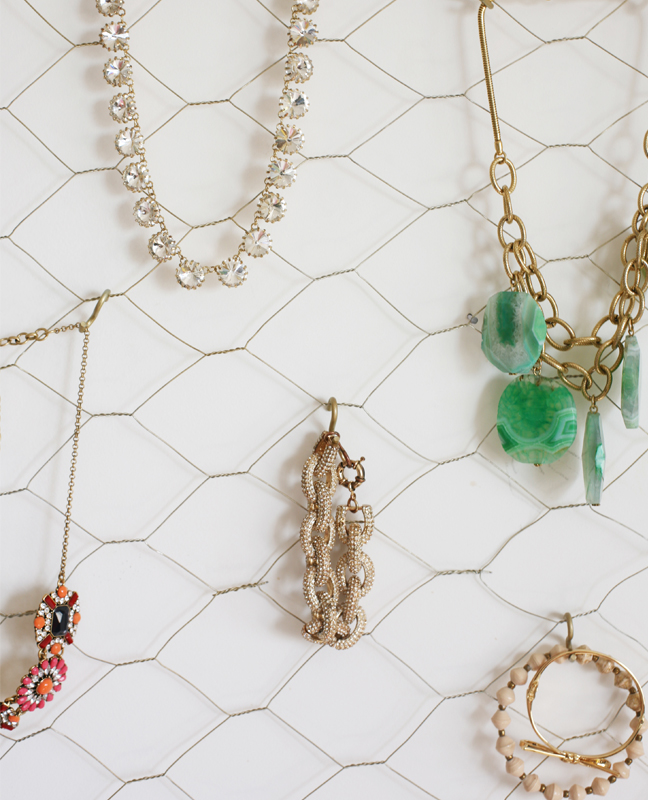 Closeup of jewelry hanging off the frame