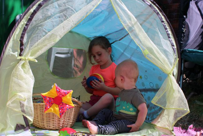 baby and child in anti-uv suntent