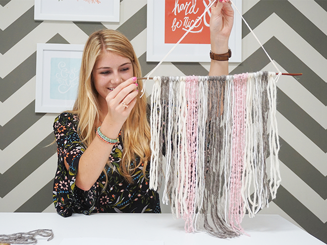 complete pink, grey and white yarn tapestry