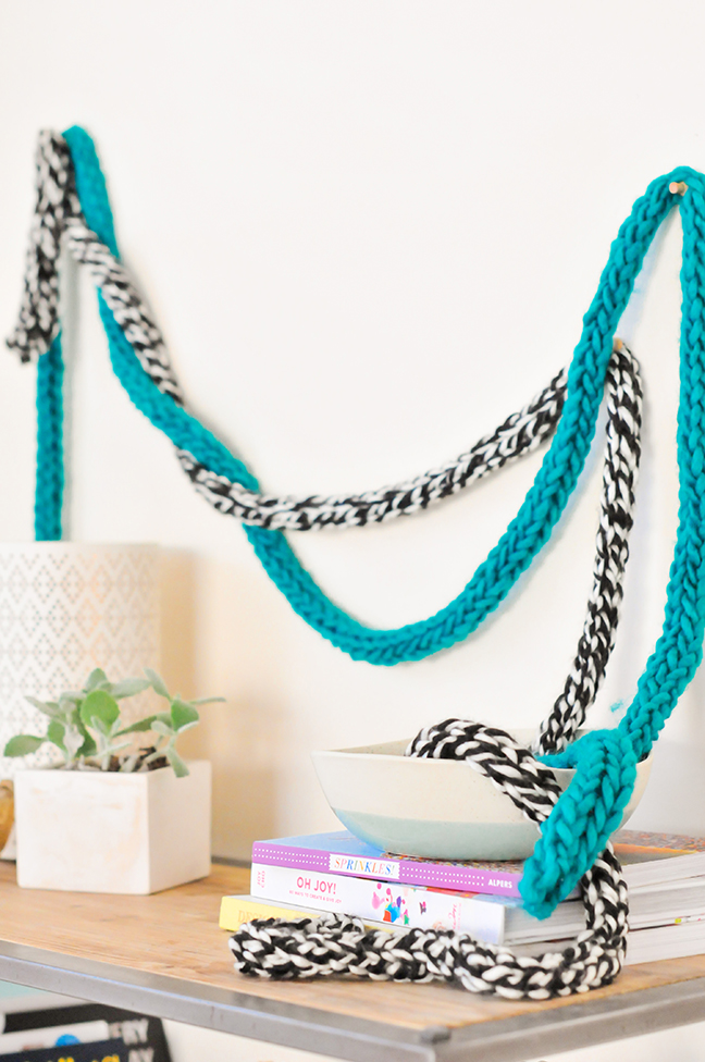 DIY Fingerknit Garlands styled on a wall