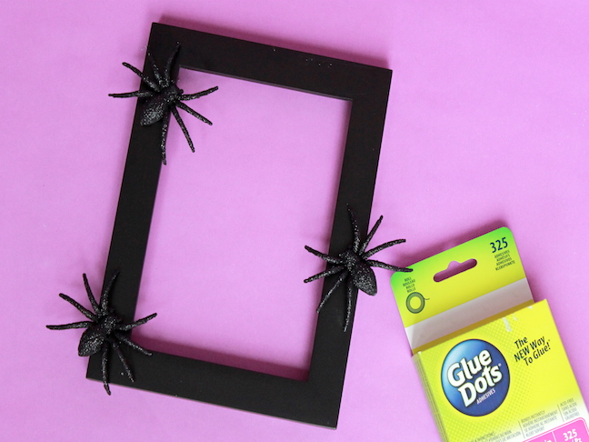Frame Step 3 glitter spiders on black photo frame