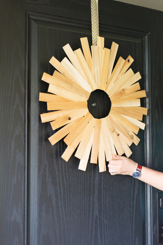 hand-wood-starburst-wreath-on-door