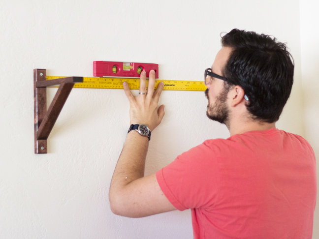 level-measuring-tape-hanging-shelf-bracket