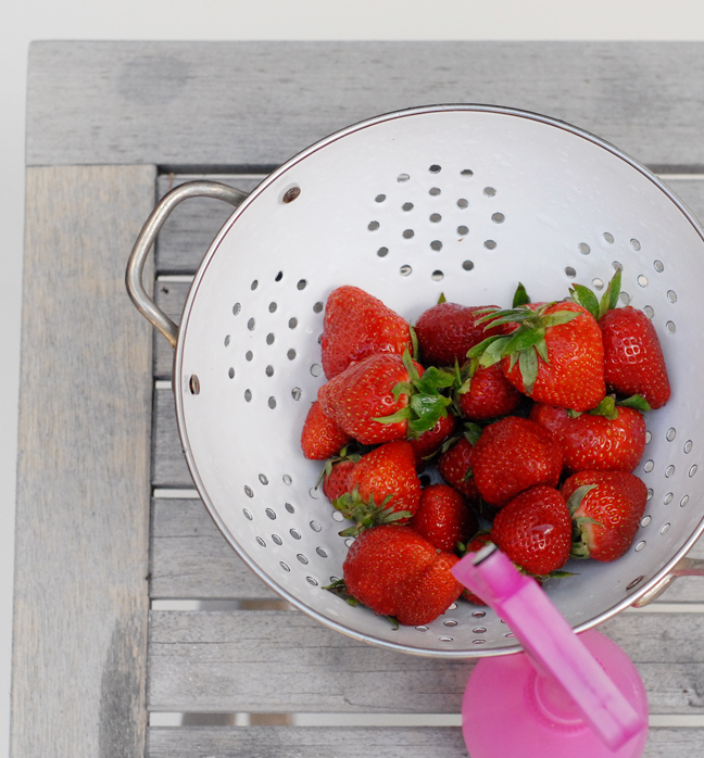 strawberries in white strainer