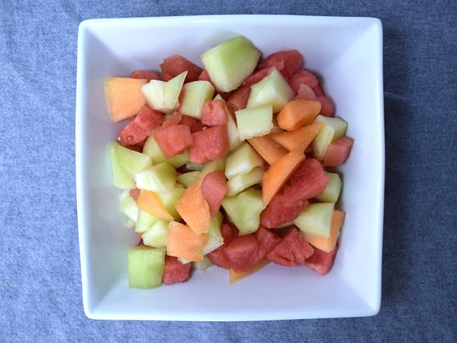melon chunks in white dish