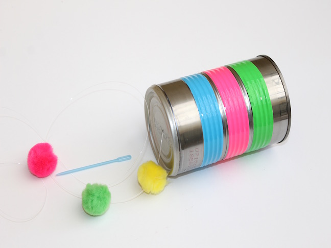 tin can wrapped in duct tape with pom poms