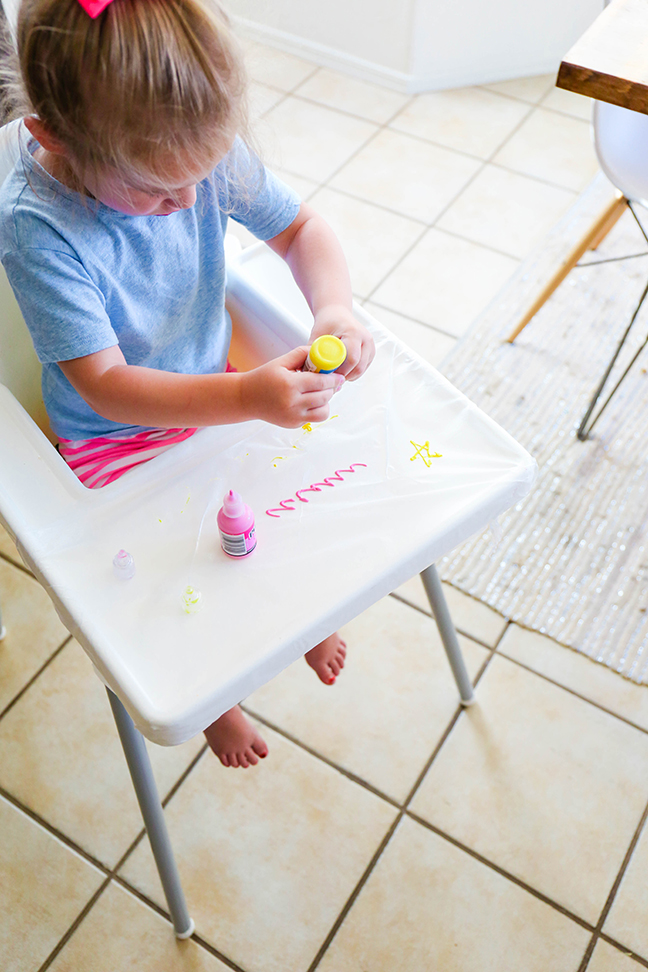 Maintain messes during craft time by painting over plastic wrap \\ \\ Toddler Proofing Tricks You've Never Heard of Before