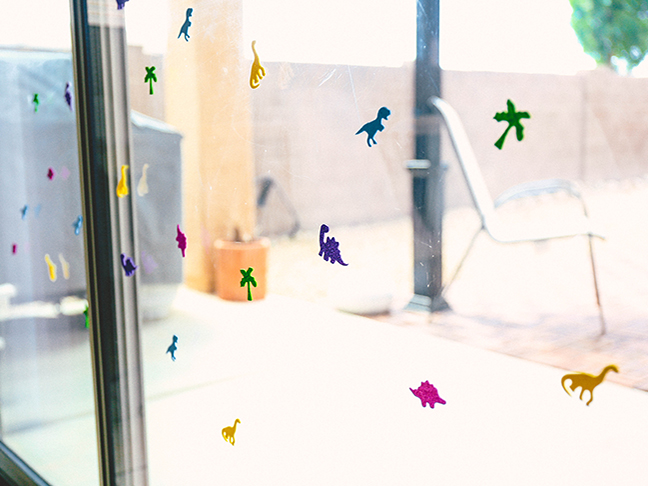 Prevent toddlers from running into glass doors by adding stickers and decals \\ Toddler Proofing Tricks You've Never Heard of Before