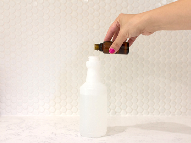 hand-pouring-essential-oils-into-spray-bottle