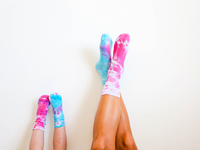 blue and pink tie dyed socks on mom and toddler