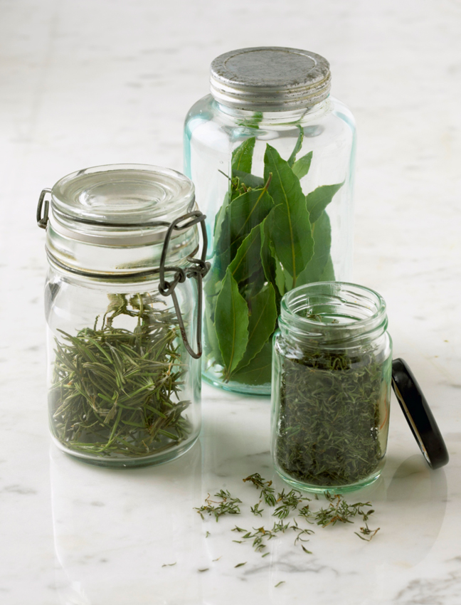 green herbs glass jars