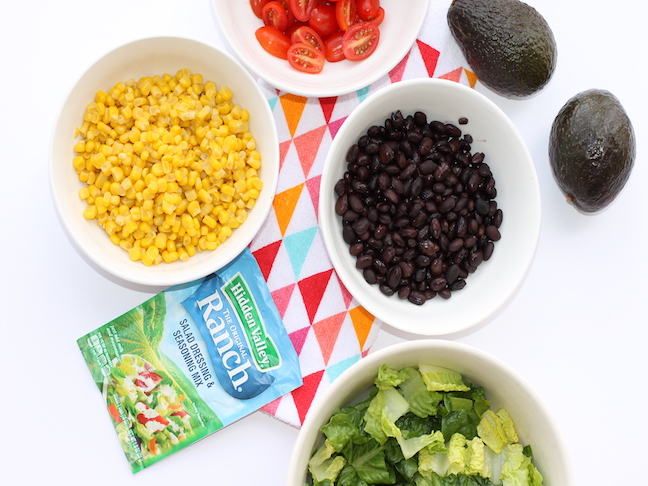 bowls of corn, black beans, tomatoes, lettuce