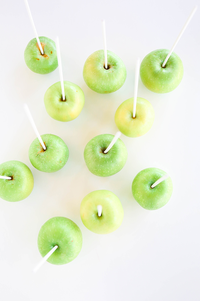 green apples with lollipop sticks