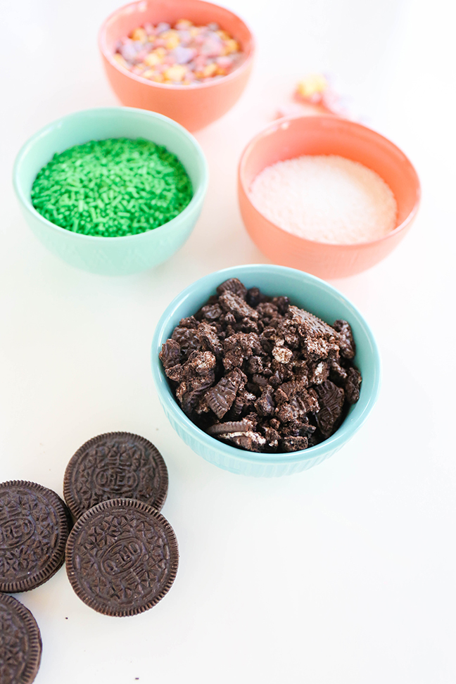 bowl of crushed oreos and green sprinkles