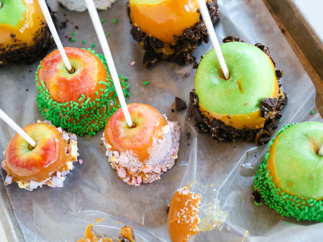caramel apples dipped in colorful candies