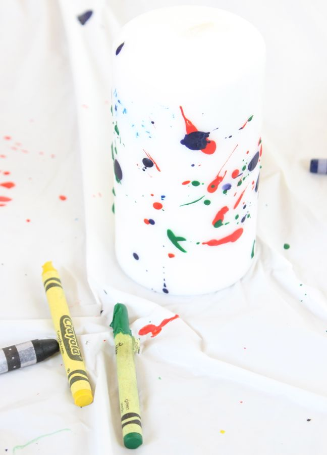 splattered crayons on white candle