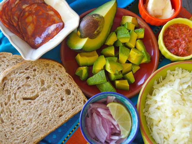 avocado-green-red-grated cheese-sliced onion-bread