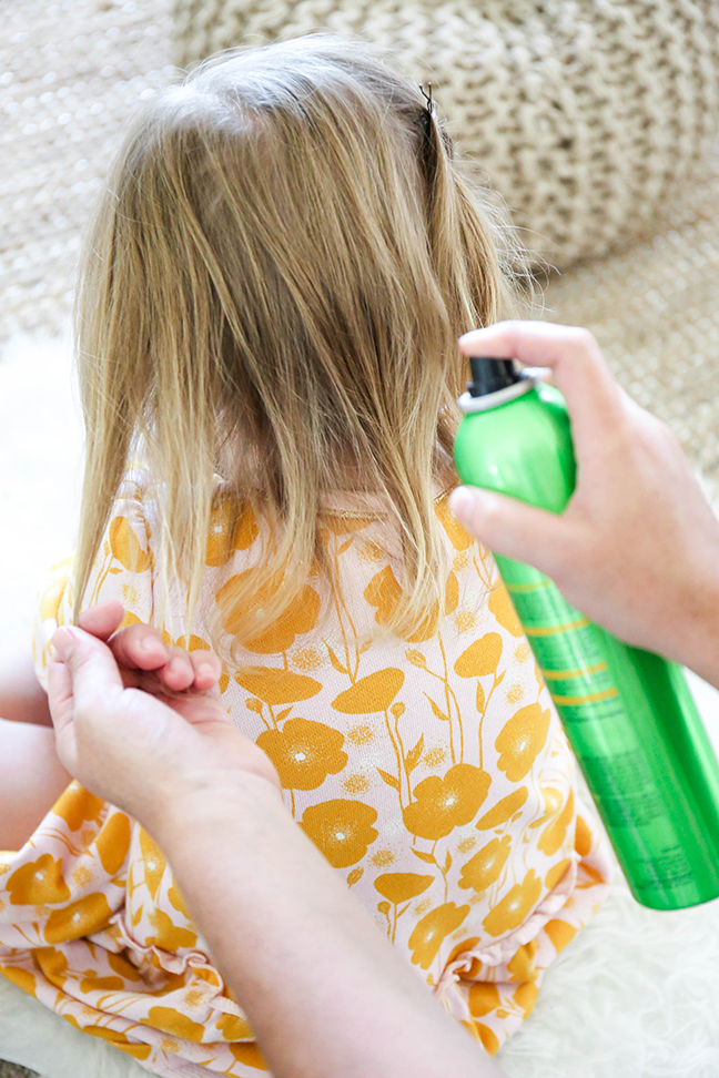 adding hairspray to kid's hair