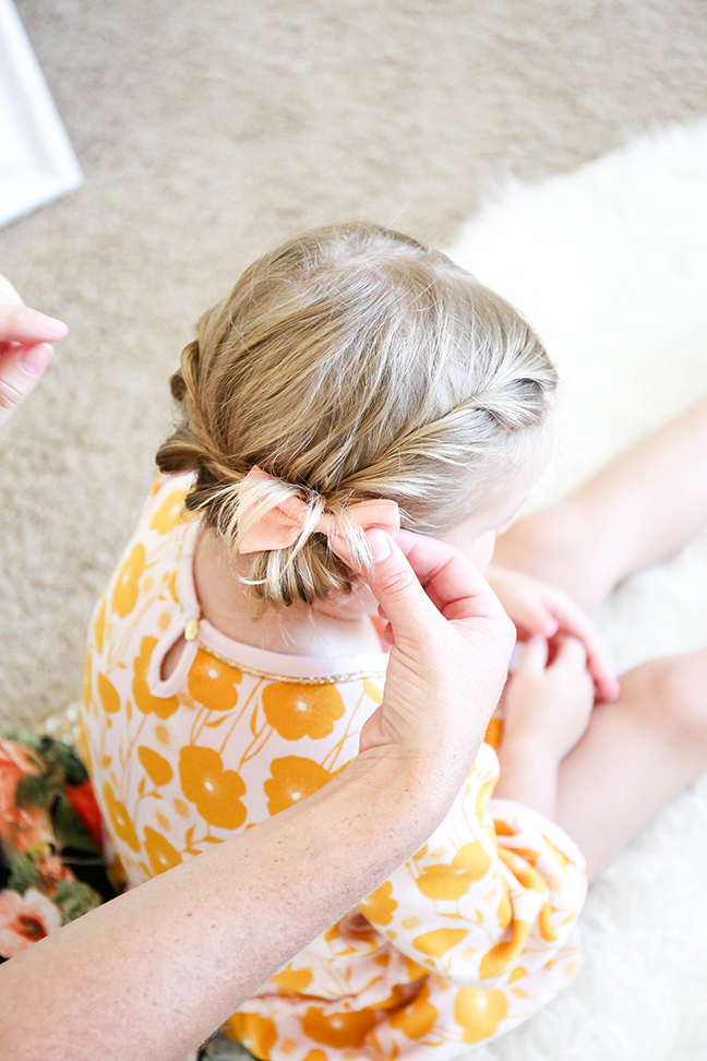 adding bow to toddler braid
