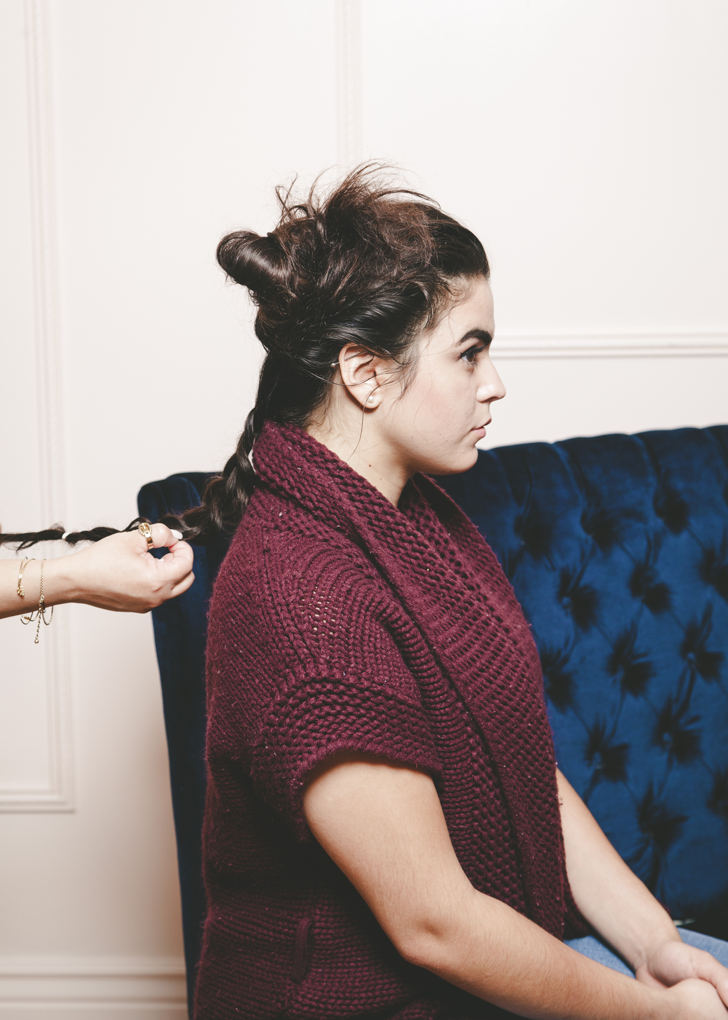 braiding hair to create top knot