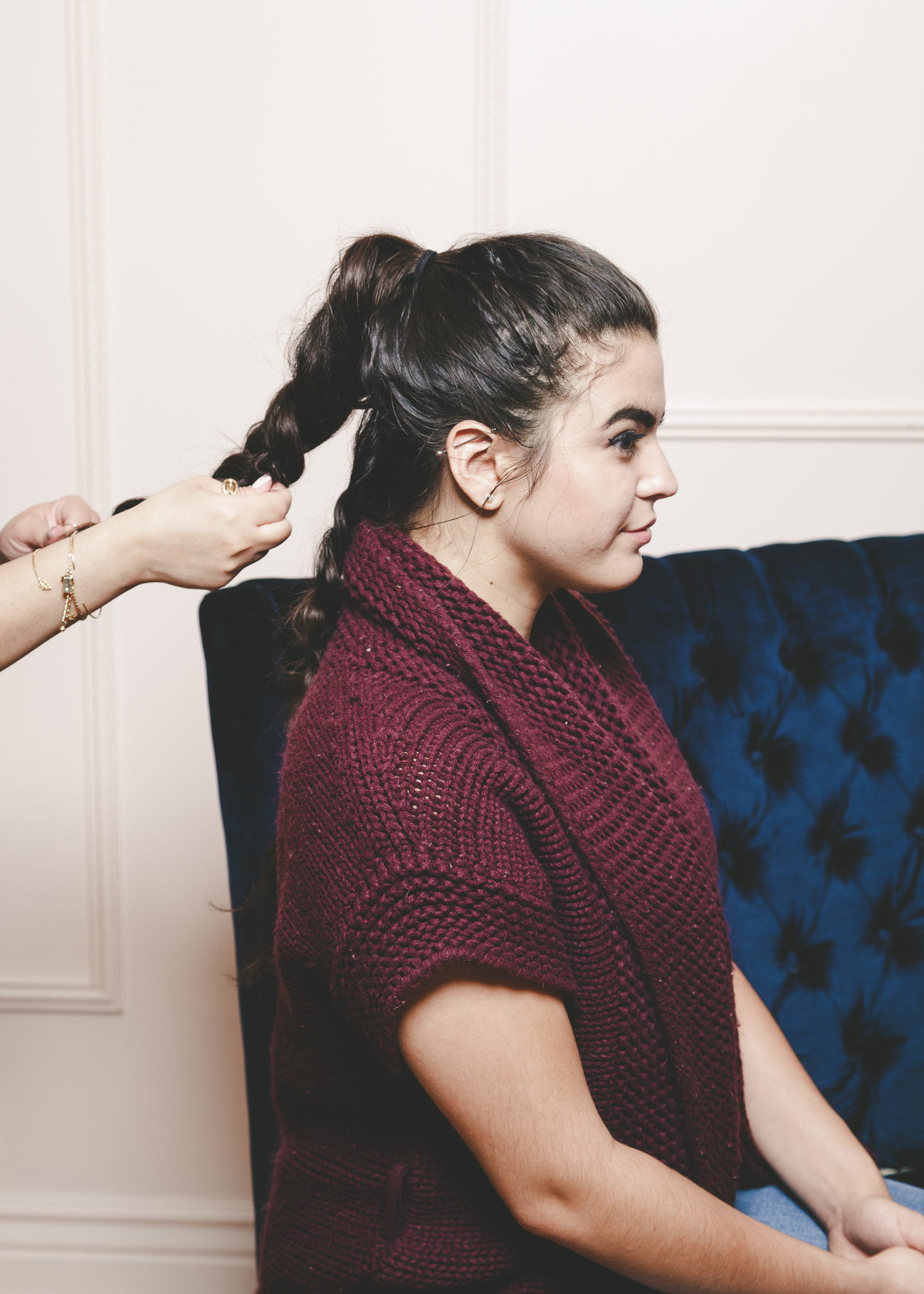 braiding a ponytail