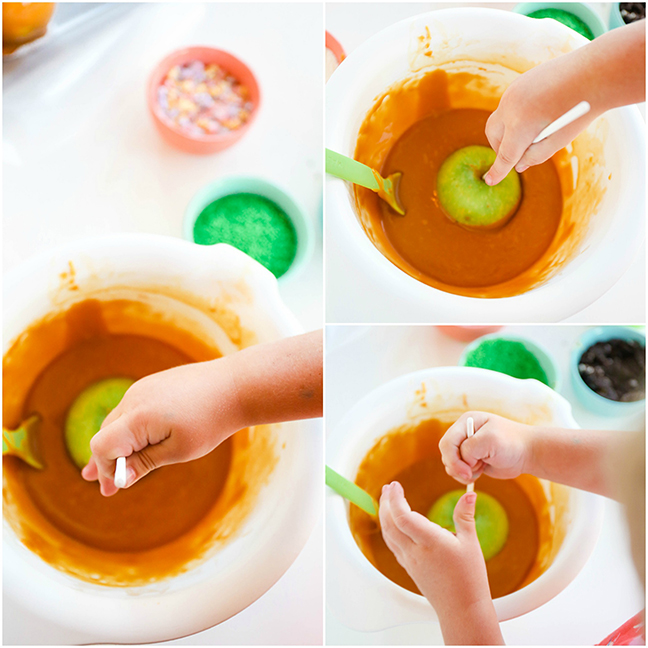 toddler dipping caramel apples