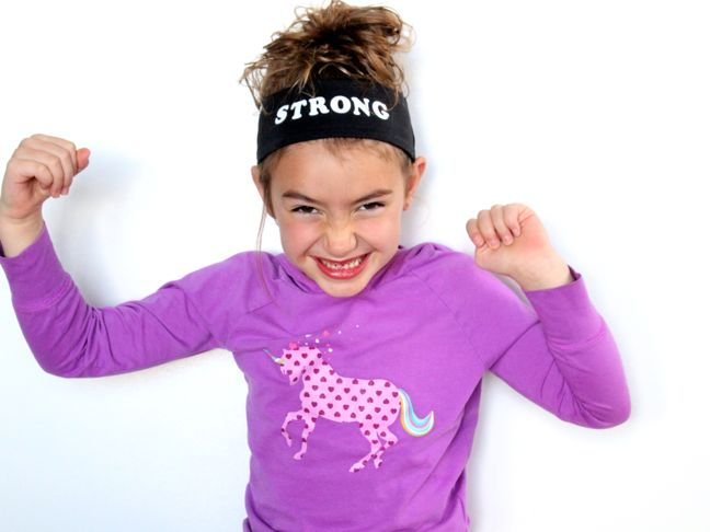girl in unicorn shirt strong headband