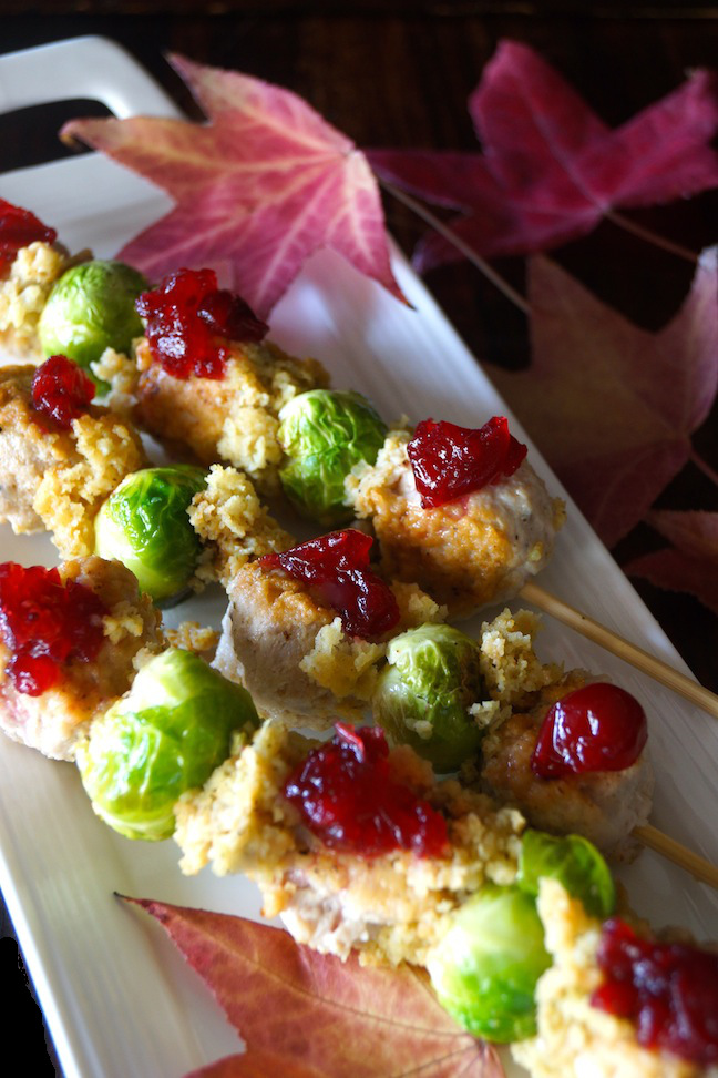 skewer-green-brussel sprout-green-meatball-cranberry-red-white plate-fall leaves