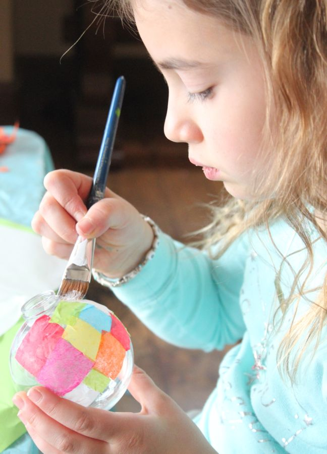 girl-painting-art-project-with-colorful-tissue-paper
