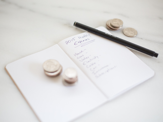 notebook-coins-pen-list-expenses-budget