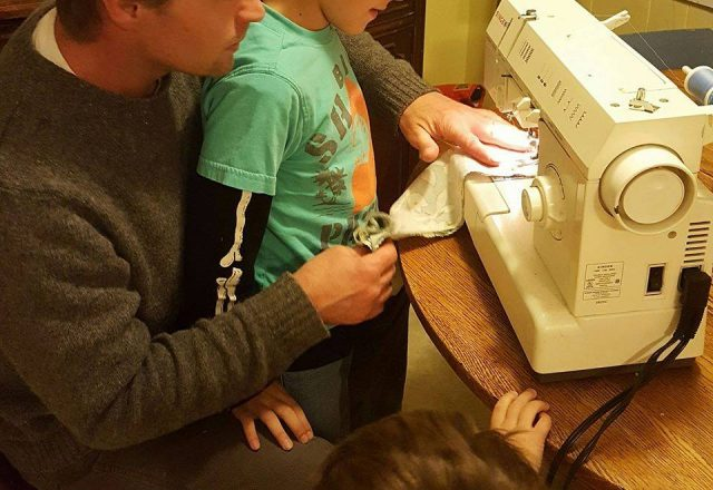 Housewife-Plus-Dad-teaching-sons-to-sew-640x440