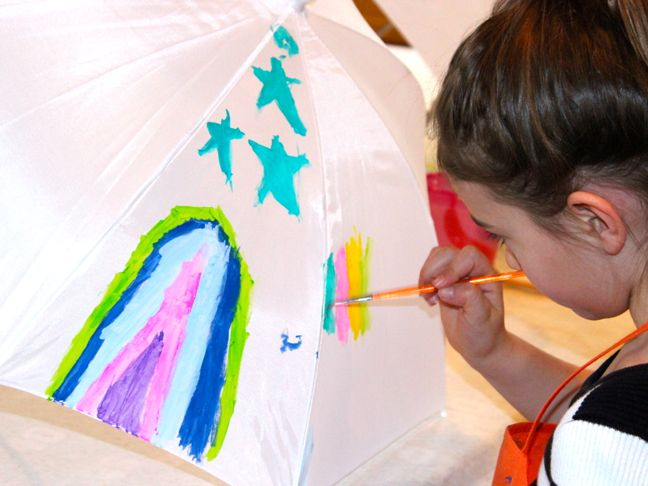 child painting umbrella