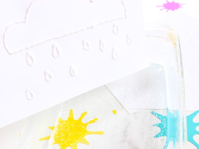 white-salt-rain-drops-on-white-paper-with-yellow-and-blue-paint-splatter
