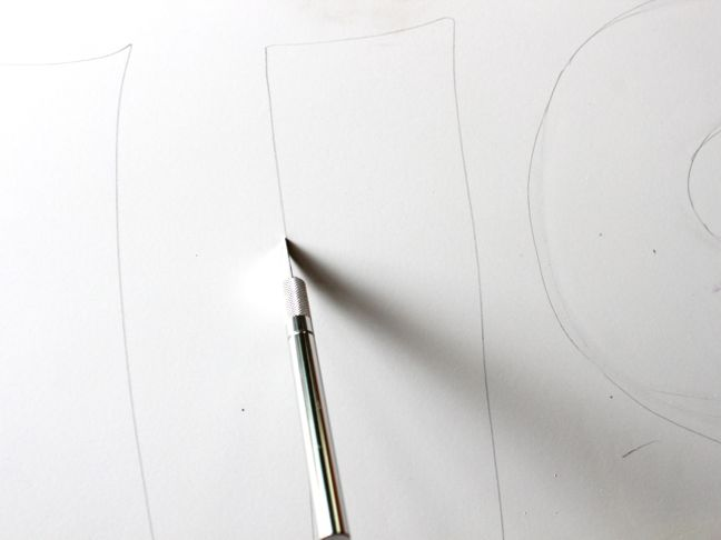 cutting out letters with xacto knife