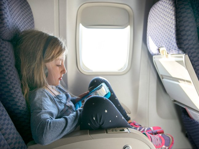 10 Sanity Savers To Bring On An International Flight With Kids