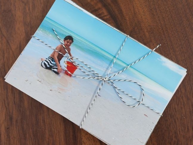 stack-of-photos-with-twine-beach-photo
