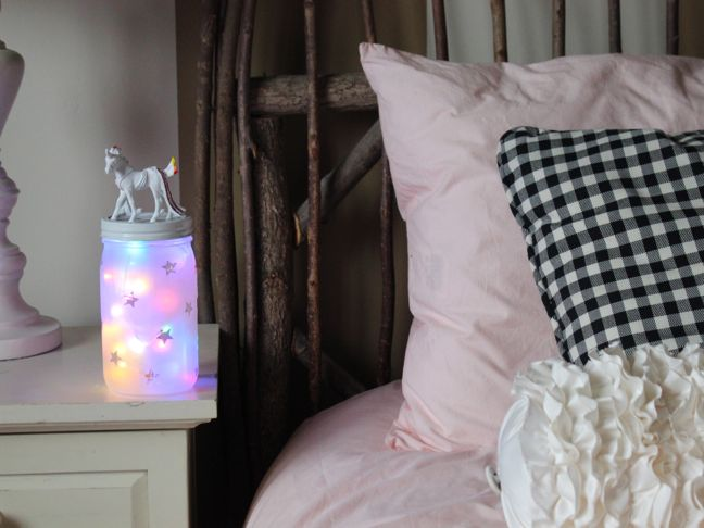 diy-unicorn-night-light-on-a-night-stand-in-a-girls-room-with-pink-bedding